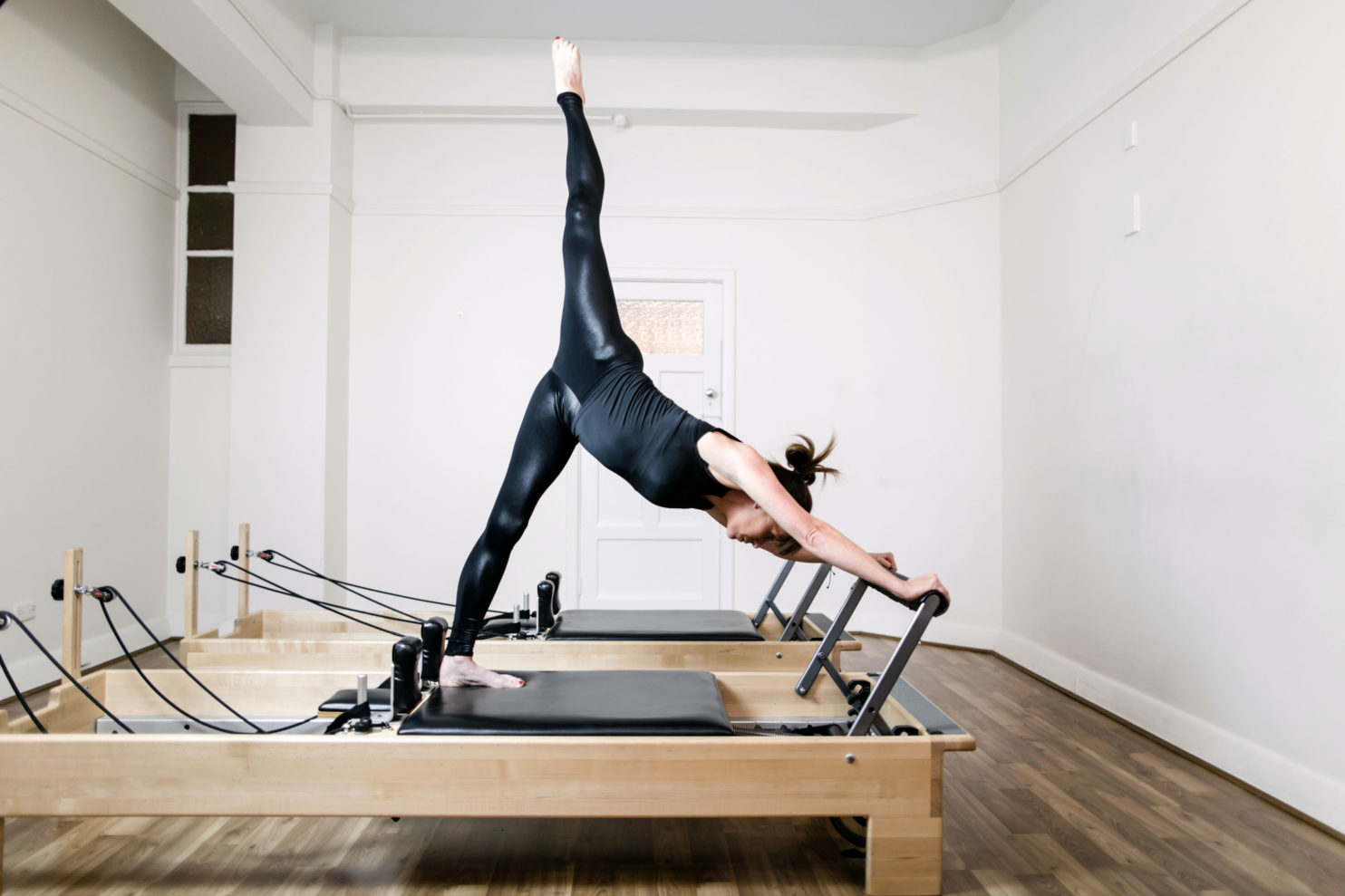 Woman on the Pilates Reformer